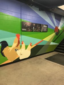 Mural in Festival Foods by Peter Krsko, with chickens, farm, and farmland