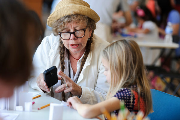 "Cartoonist and author Lynda Barry, now a member of UW-Madison's faculty, leads a ""drawing jam"" with children during a Saturday Science outreach event at the Wisconsin Institute for Discovery (WID) at the University of Wisconsin-Madison on Sept. 7, 2013. Barry, associate professor of interdisciplinary creativity and a Discovery Fellow, created the interdisciplinary Image Lab to explore the biological function of the arts. (Photo by Jeff Miller/UW-Madison)"