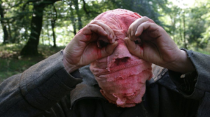 still from Timecrimes, man with bandaged face