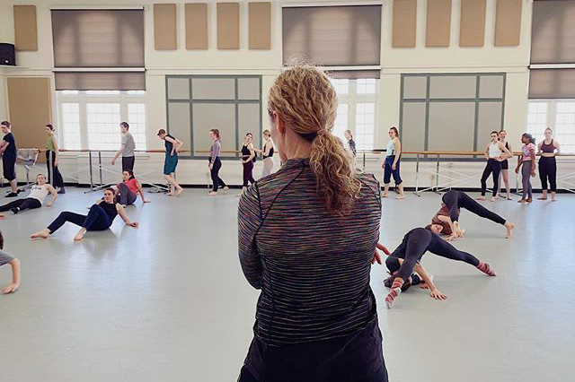Carrie Hanson observes a dance class in a studio in Lathrop Hall.