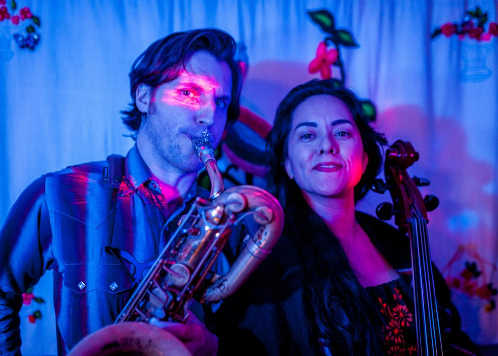 Ben Barson playing saxophone with Gizelxanath Rodriguez
