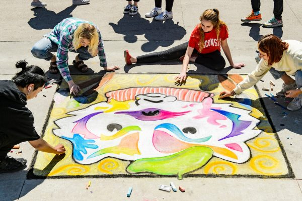 Students present their chalk art murals featuring Bucky Badger during Badgers Chalk the Block