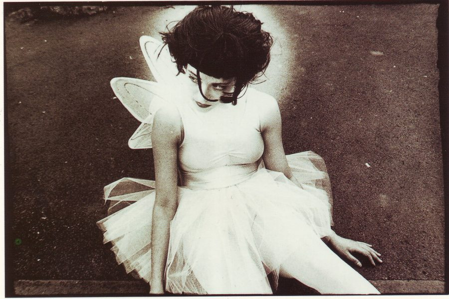 Litza Bixler sitting in a white dress with wings